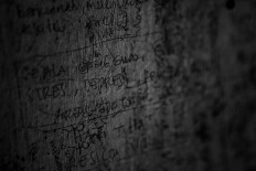 "Expressing feelings: A scribbled graffiti reads ""depression"", ""mental disorder"" and ""stress"" on the door of Rumah Peduli Sahabat Kasih in Cisauk, Banten. JP/Seto Wardhana"