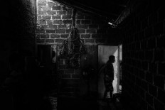 Sanctuary: A resident enters his room. JP/Seto Wardhana