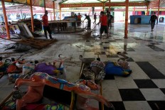 Parts of the carousel seen spread out on the ground after workers dismantled the ride. JP/Maksum Nur Fauzan