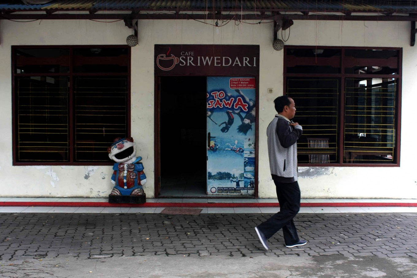 A man walks past an empty Sriwedari cafe on May 12, 2017. JP/Maksum Nur Fauzan
