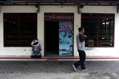 A man walks past an empty Sriwedari cafe on May 12, 2017. JP/Maksum Nur Fauzan