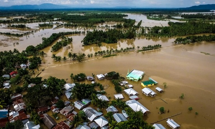 A general view of the flooded Municipality of Kabacan, North Cotabato, on the southern island of Mindanao on December 23, 2017, after Tropical Storm Tembin dumped torrential rains across the island. The death toll from a tropical storm in the southern Philippines climbed swiftly to 133 on December 23, as rescuers pulled dozens of bodies from a swollen river, police said.