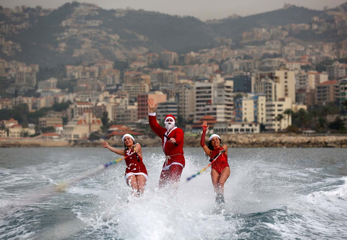Members of a Lebanese water ski club perform while dressed in Santa Clause outfits in the bay of Jounieh on December 22, 2017. AFP/Patrick Baz