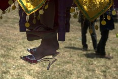 Girls will step their feet on the soil for the first time during the ceremony after being circumcised and isolated. Antara/Rosa Panggabean