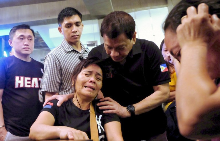 Duterte vows to get to truth of deadly mall blaze