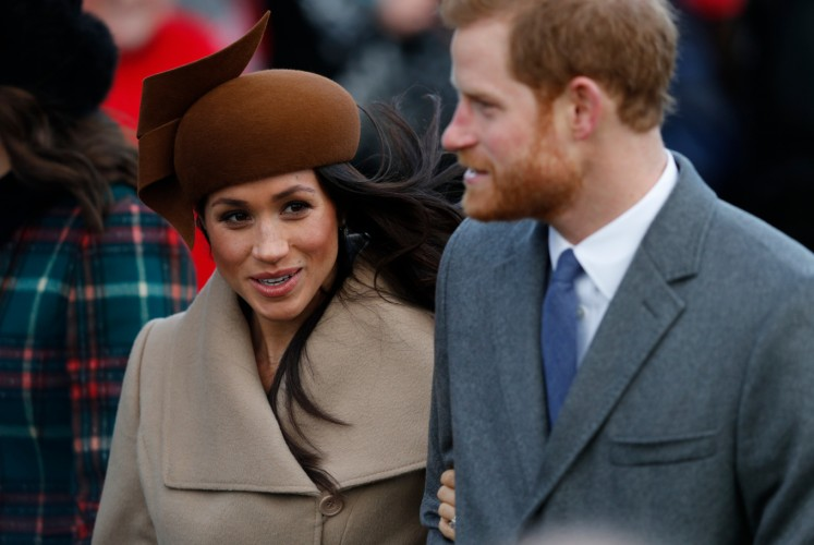 US actress and fiancee of Britain's Prince Harry Meghan Markle and Britain's Prince Harry arrive to attend the Royal Family's traditional Christmas Day church service at St Mary Magdalene Church in Sandringham, Norfolk, eastern England, on December 25, 2017.