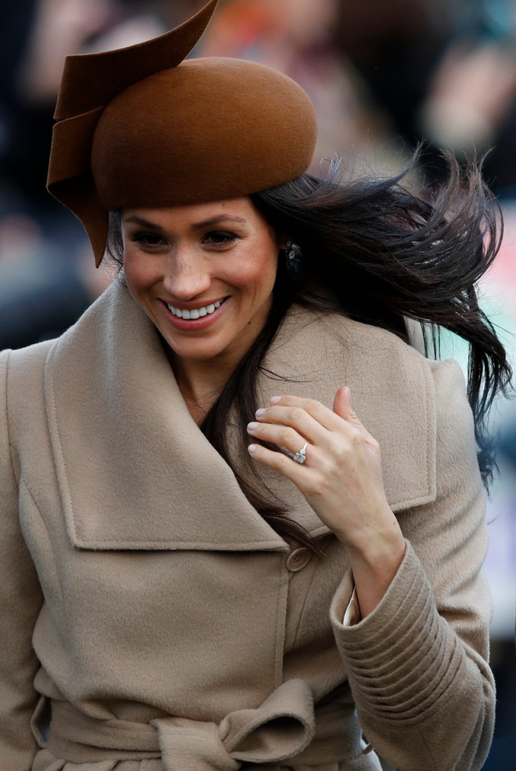 US actress and fiancee of Britain's Prince Harry Meghan Markle arrives to attend the Royal Family's traditional Christmas Day church service at St Mary Magdalene Church in Sandringham, Norfolk, eastern England, on December 25, 2017.