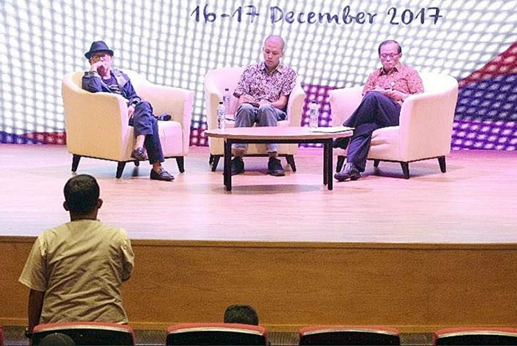 Let's talk: Filmmaker and literature activist Richard Oh (left) and Supriyanto (right), the chief librarian of the National Library, listen to a question from a participant at the recent festival.