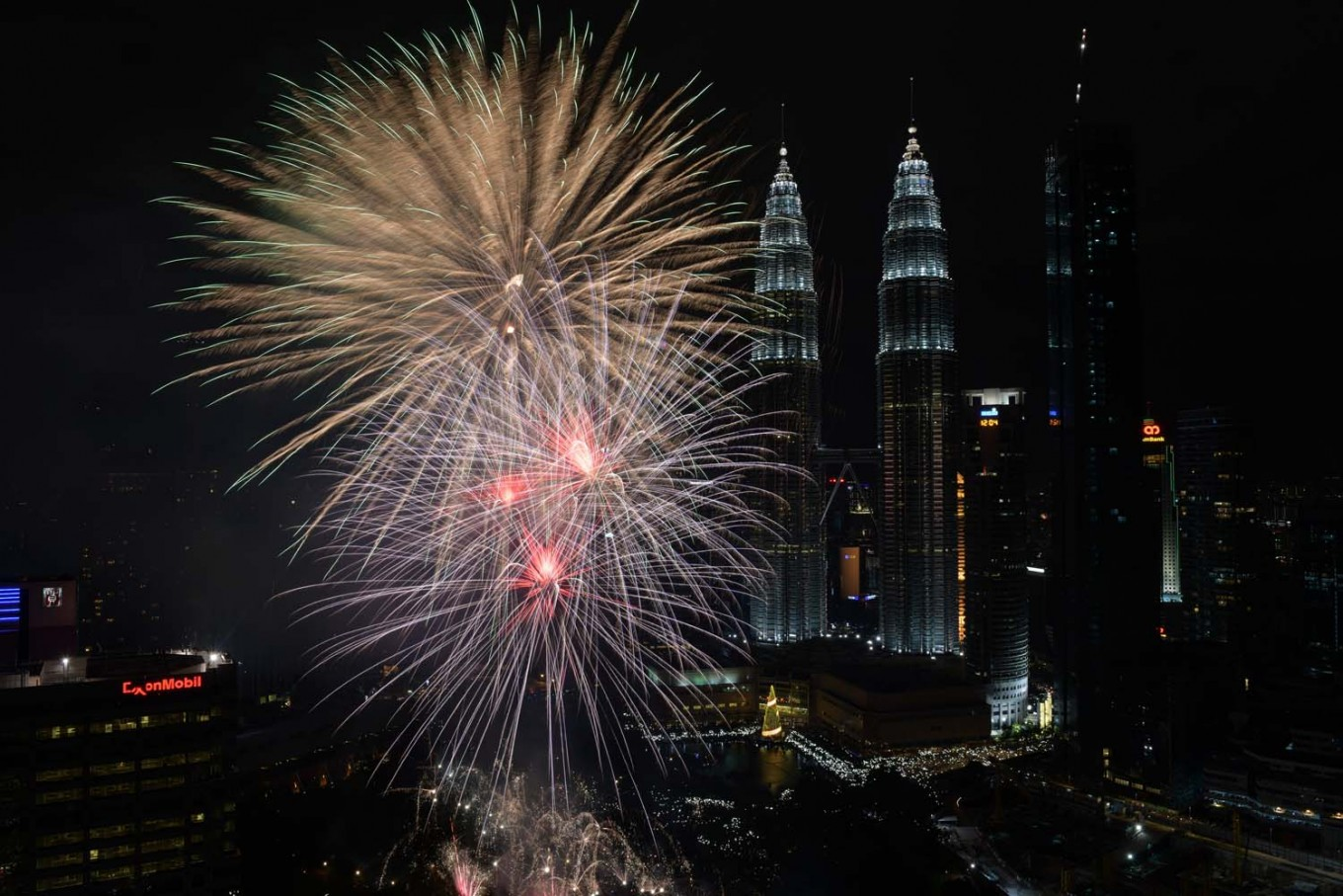 Fireworks illuminate the sky near Malaysia's Petronas Twin Towers during New Year celebrations in Kuala Lumpur on January 1, 2018. AFP/Mohd Rasfan