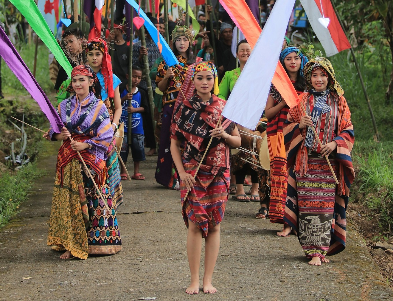 The festival was kicked off with a flag parade from Gerdu village to a rice field.