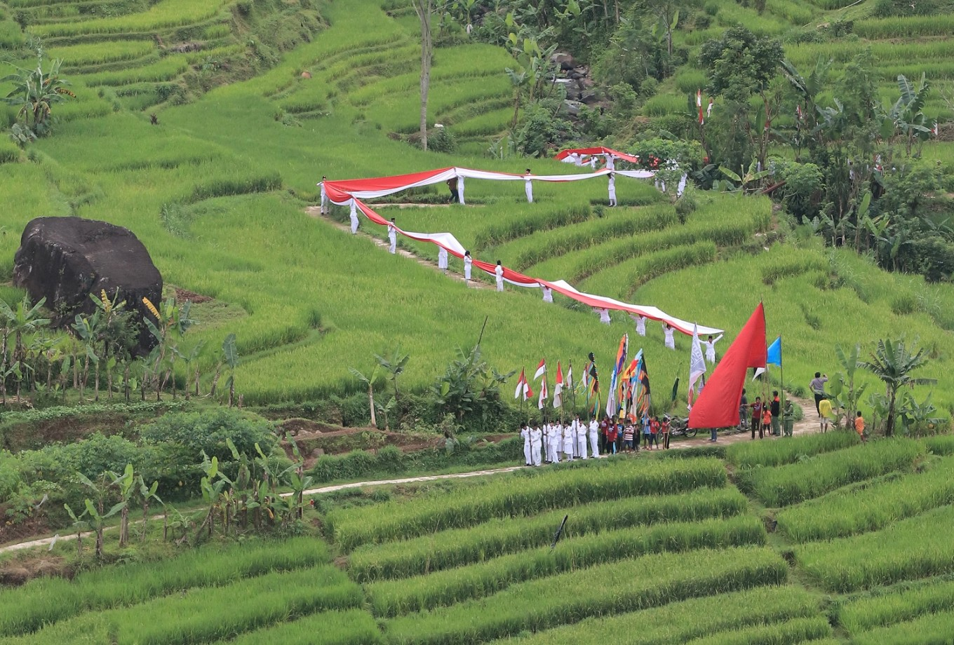 A flag 15 meters long is carried during the Mount Lawu Flag Festival.