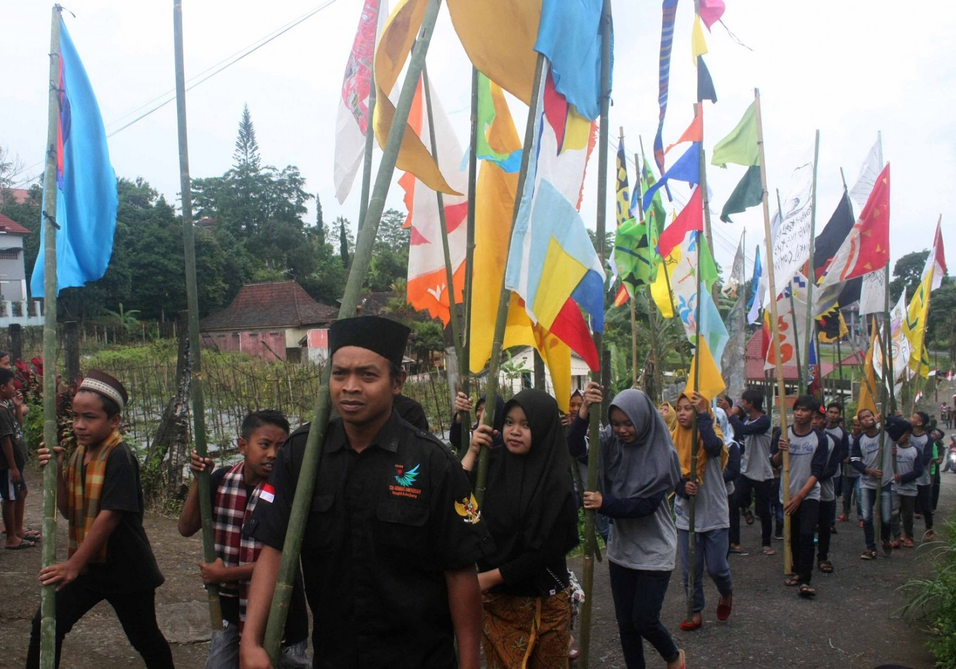 Gerdu village residents participate in a flag parade.