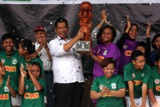 Members of Putri Mataram Yogyakarta celebrate at the trophy presentation. JP/Maksum Nur Fauzan