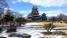 Snow starts to melt in front of Matsumoto Castle in the city of Matsumoto. JP/Agnes Anya