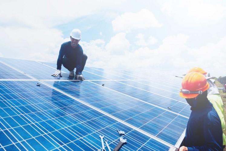 Engineers working on solar panel.