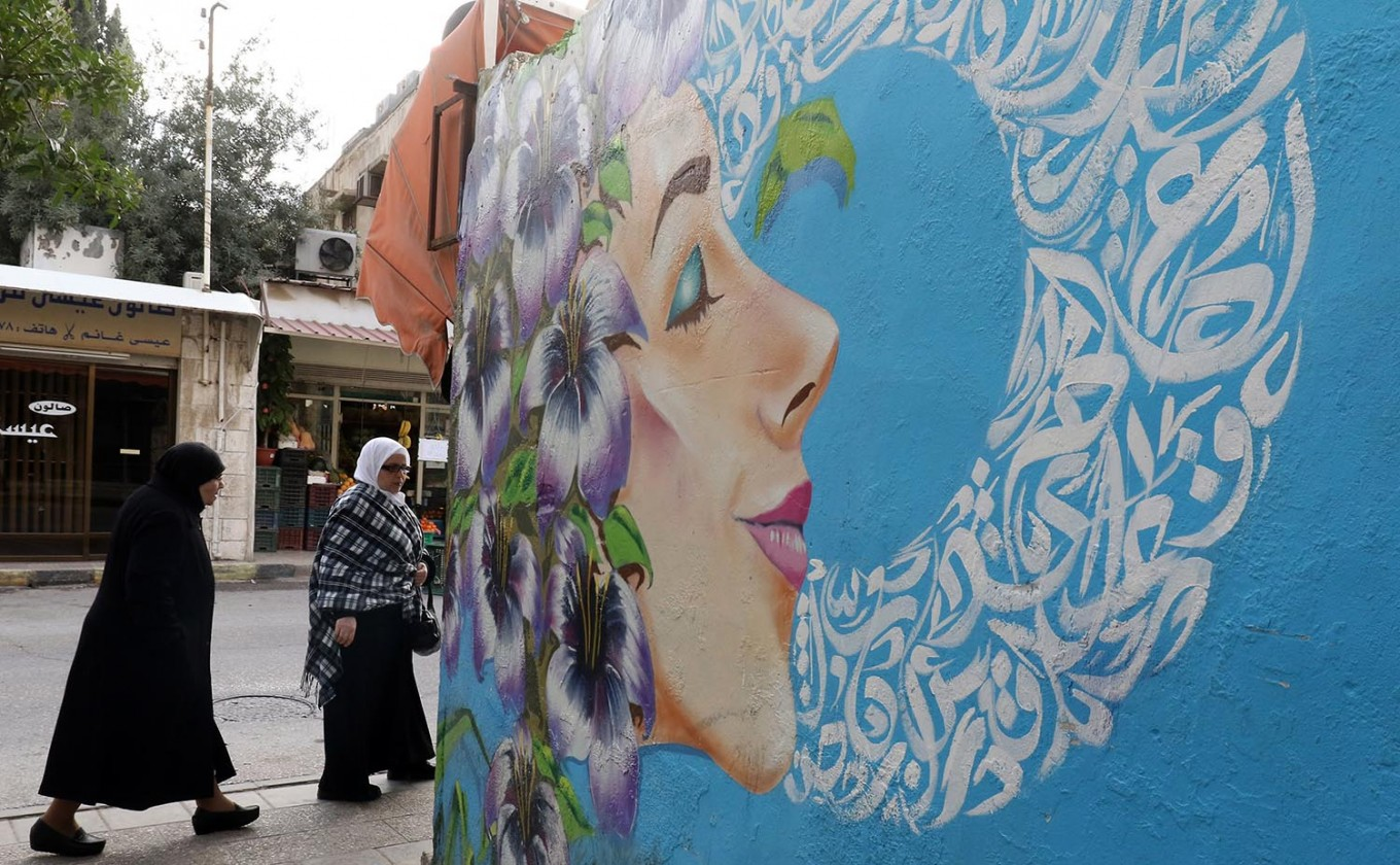A picture taken on December 18, 2017 shows a graffiti mural on a wall in the Jordanian capital Amman. A tiny group of graffiti artists are on a mission -- daubing flowers, faces and patterns across the capital Amman to bring more colour to the lives of its four million inhabitants.