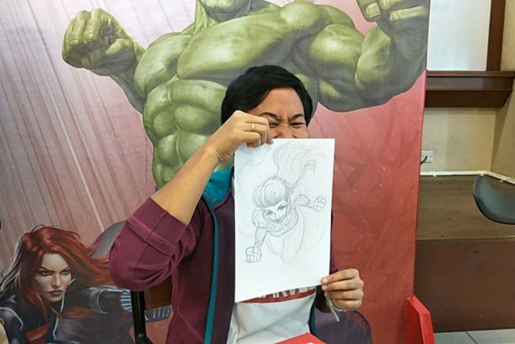 "Miralti ""Alti"" Firmansyah with her sketch of the superhero version of Syahrini."