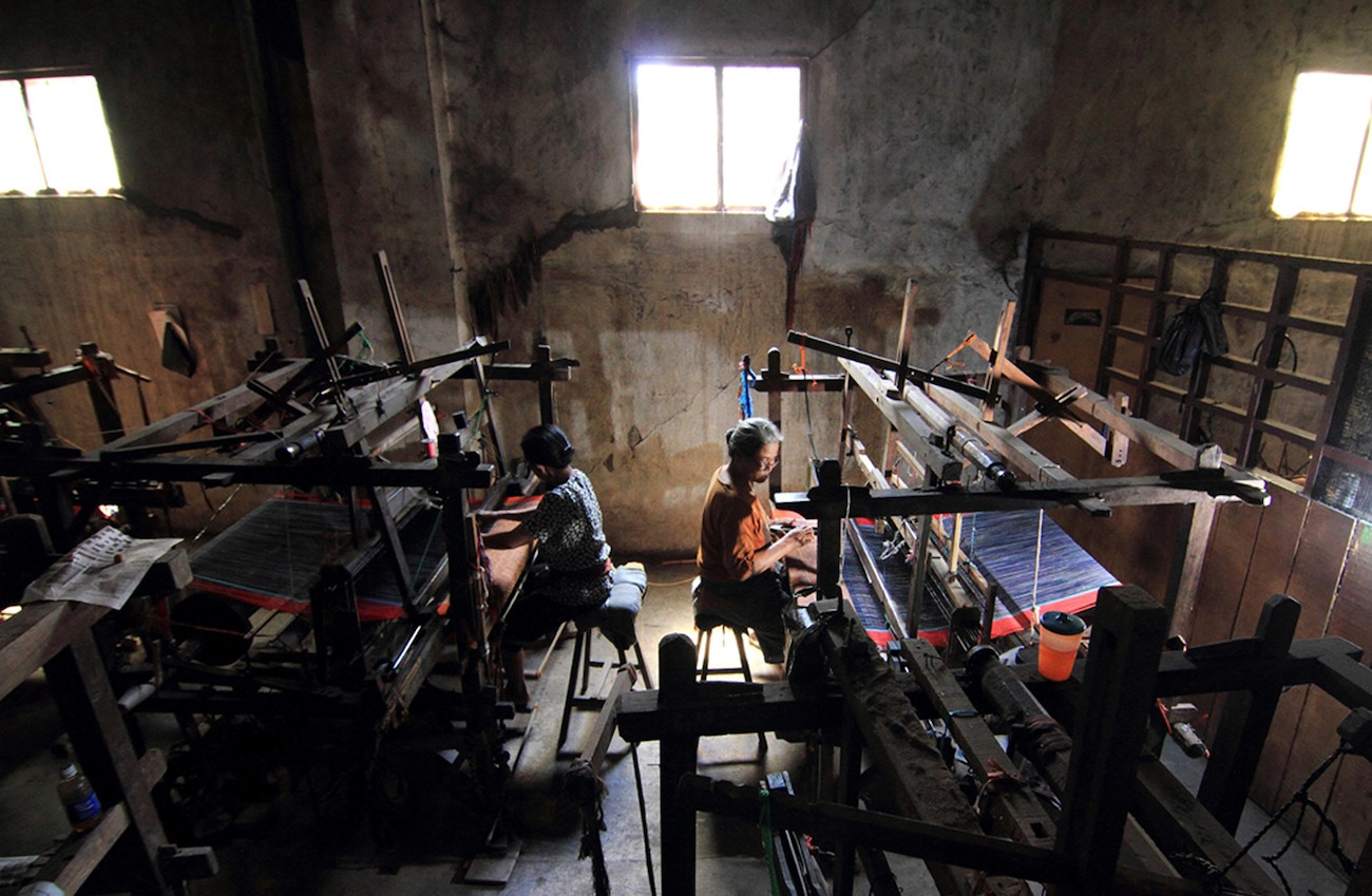 Workers at the woven lurik workshop in Pedan, Klaten, Central Java. Most of the workers are 60 to 70 years old