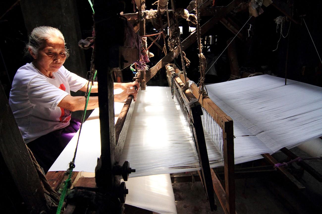 Tukinem, 70, weaves 'lurik' using a manual loom in Tlingsing village, Pedan district, Klaten, Central Java.