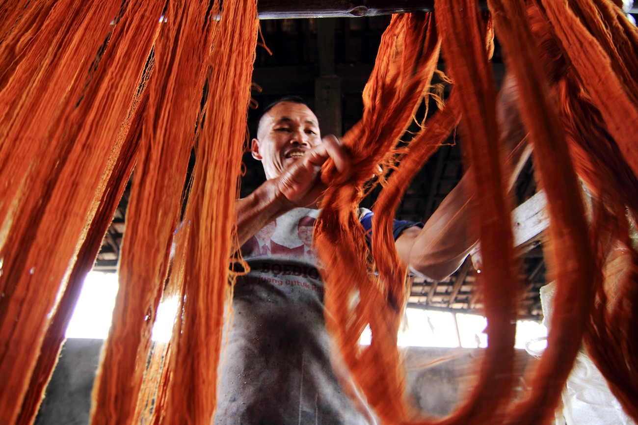The yarn is dried before it is woven to make 'lurik.'