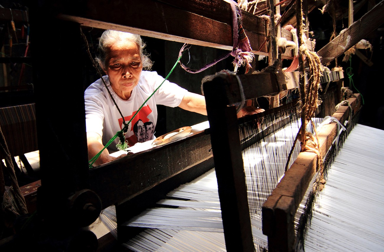 Tukinem, 70, weaves 'lurik' using a manual loom at Tlingsing village in Pedan district, Klaten, Central Java.