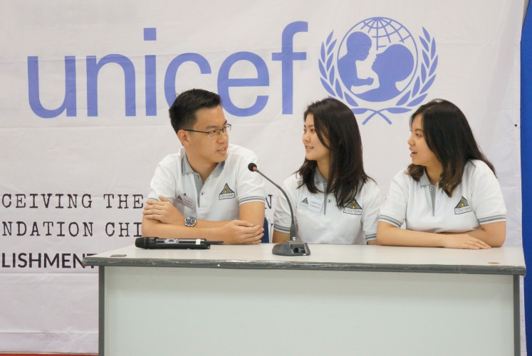 Some of the core members of Streetizens, Timothy Sam Wijaya (left), Sabrina Hartono (center) and Felicia Widjaya, talk about their organization.