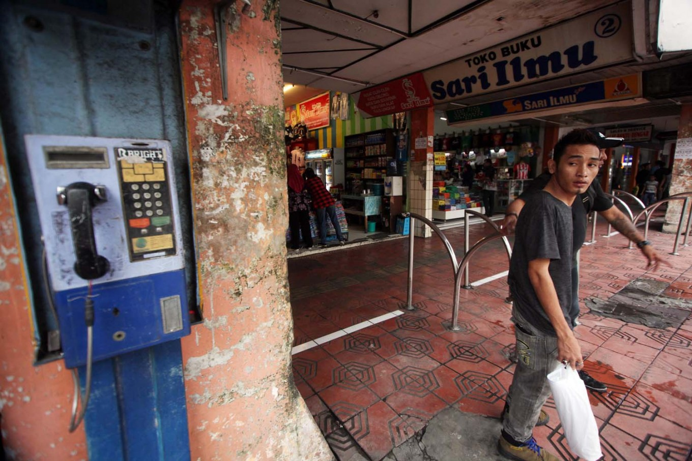 Two men exit a building on Malioboro. JP/Boy T. Harjanto
