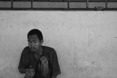 A patient daydreams. Antara/Hafidz Mubarak