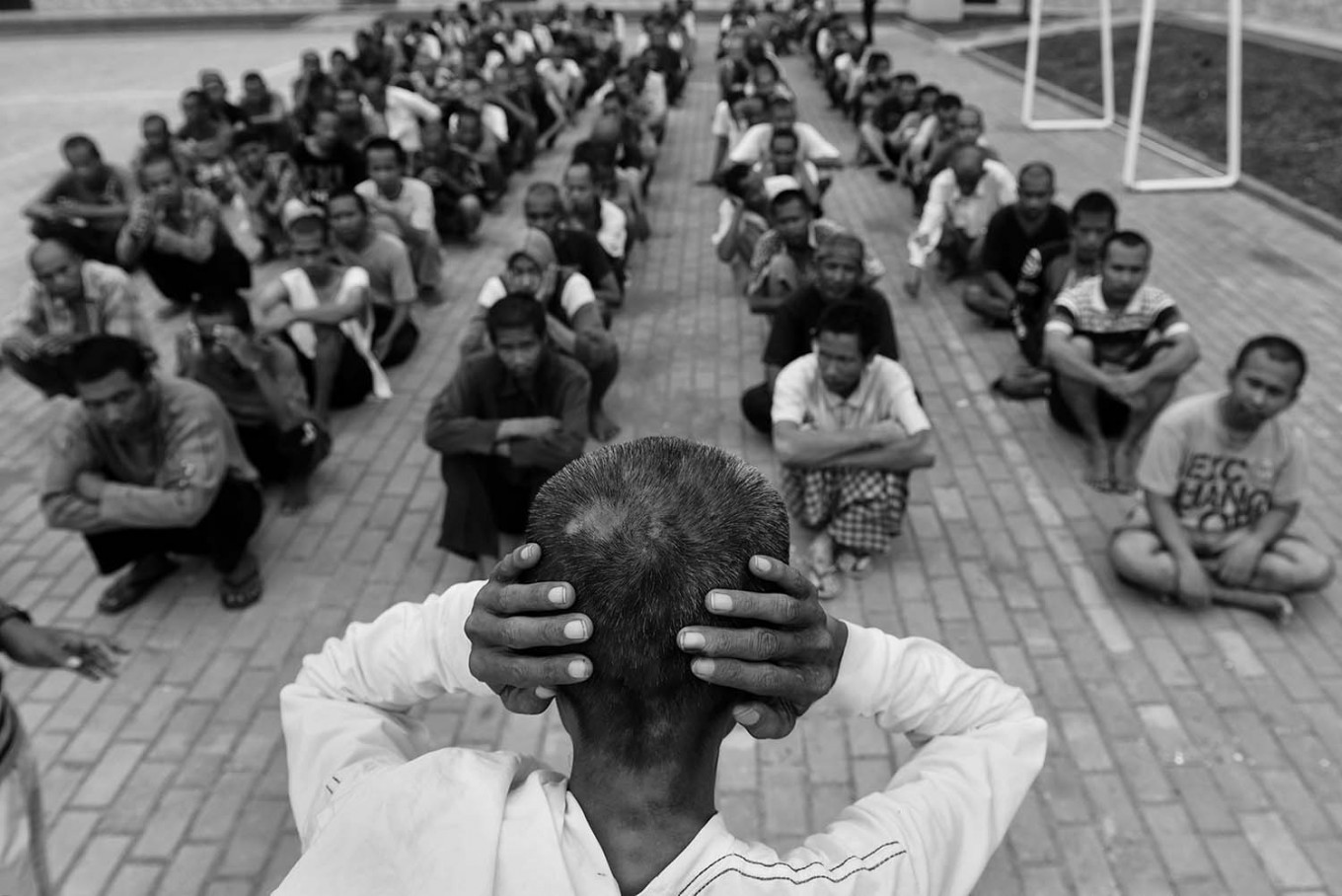 A patient shows his colleagues how to get rid of hallucinations by covering his ears. Antara/Hafidz Mubarak