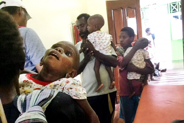 Malnourished siblings Epi (left), Arfat (center) and Poma from Sarwamok in Agats district, Asmat regency, Papua, are transferred to Agats General Hospital. The children were found by paramedics who had been deployed in response to a measles outbreak in early 2018. The journey from Asmat's capital to Agats regency takes several hours by boat.