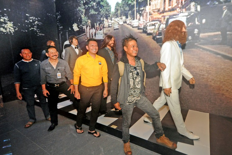 On the road again: Indonesian reggae artist Tony Q Rastafara (in front) and several visitors take to the road with The Beatles.