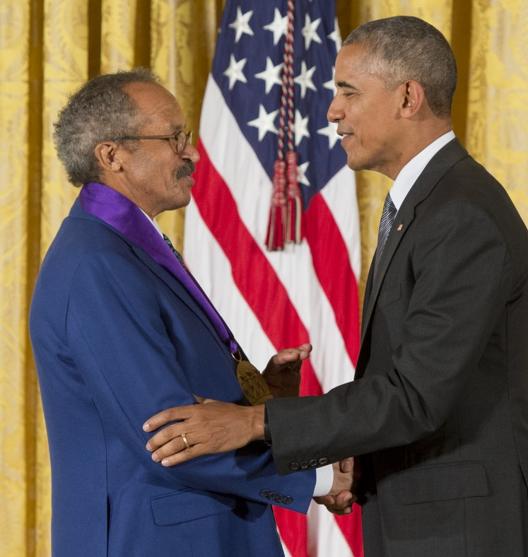 US President Barack Obama presents painter Jack Whitten with the 2015 National Medal of Arts during a ceremony in the East Room of the White House in Washington, DC, September 22, 2016.