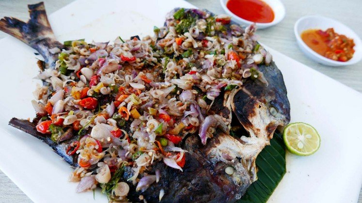 Grilled fish served with Balinese-style chopped sambal at Seafood City Bandar Djakarta restaurant.
