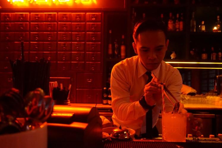 Bartender creates a cocktail at Pao Pao Liquor Bar and Dimsum Parlour.