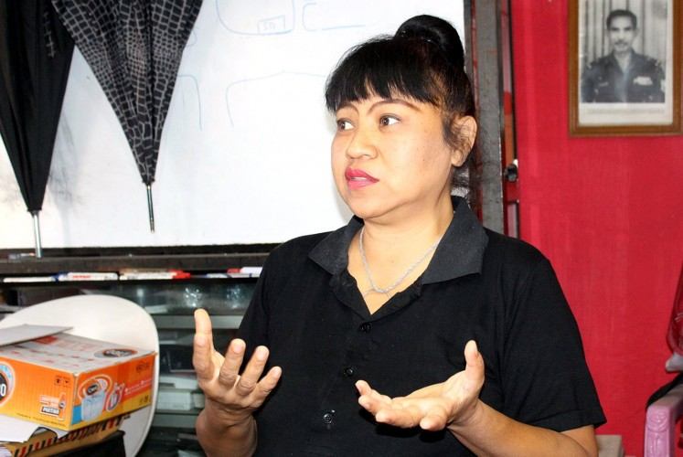 Asri Rahayu Agustina or Leotina, the owner of a shelter for cats and dogs in Malang.
