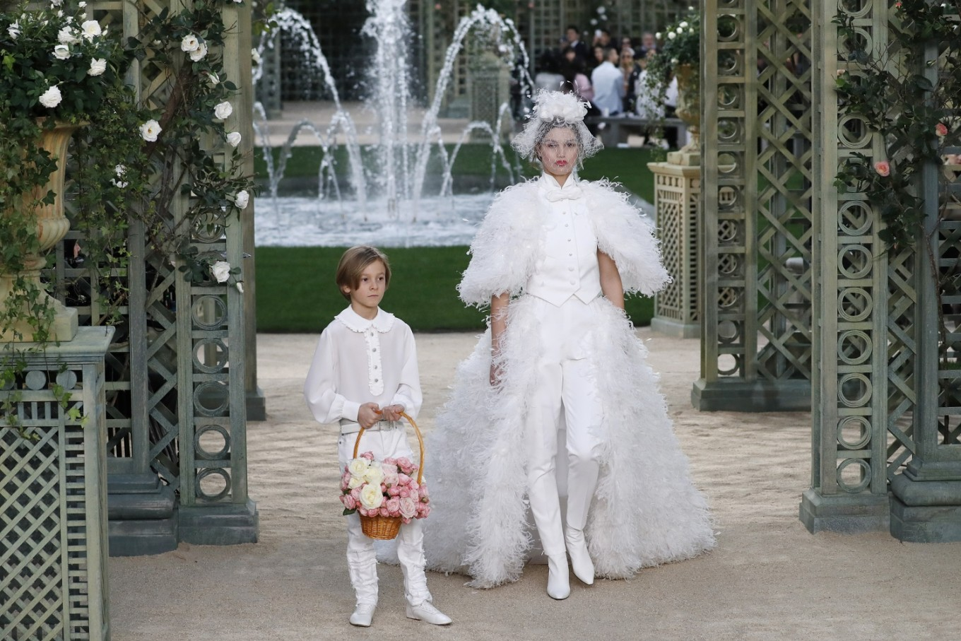 A model presents a creation with Karl Lagerfeld's godson Hudson Kroenig for Chanel during the 2018 spring/summer Haute Couture collection fashion show on January 23, 2018 in Paris.