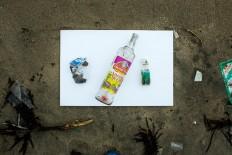 Wasted: Wine bottles that washed up on Kuta Beach. JP/Agung Parameswara.