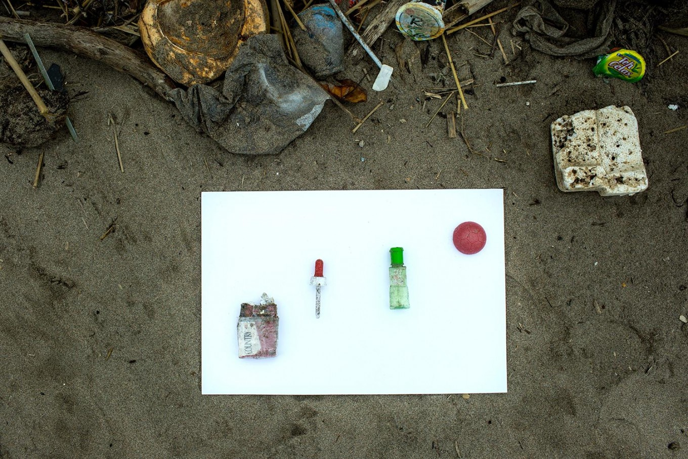 Strange bedfellows: A cigarette, a bottle of medicine, a pipette and a plastic ball collected on Kuta Beach. JP/Agung Parameswara.