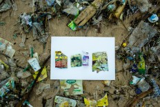 Leftovers: Empty snack packets and a bottle of milk that were found on Jimbaran Beach in Bali. JP/Agung Parameswara.
