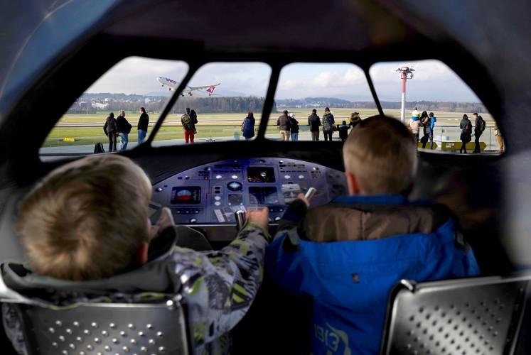 Children play at being pilots at Zurich International Airport