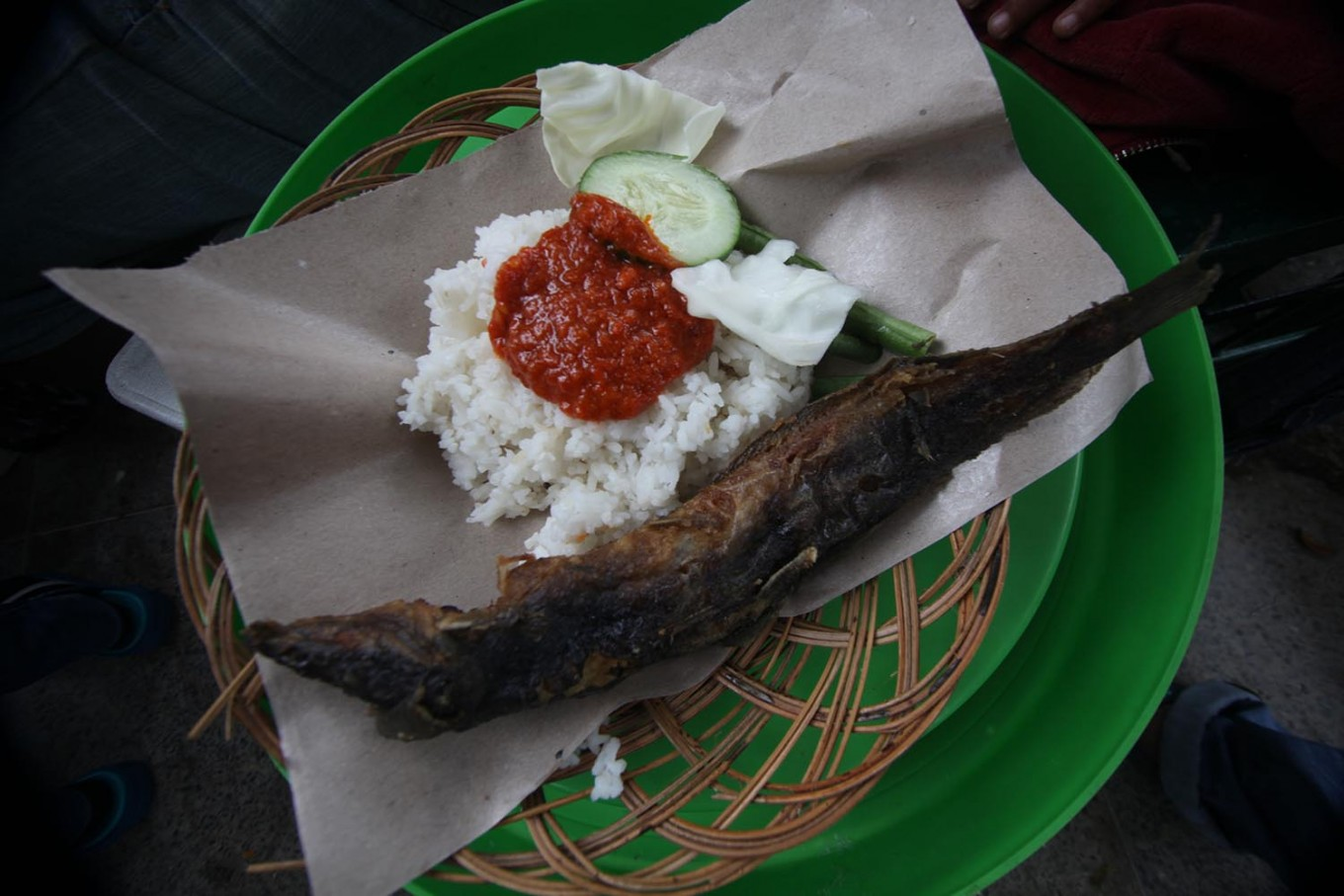 The free meal at Shodaqoh food stall consists of a portion of rice, fried catfish, sambal and vegetables. JP/ Boy T. Harjanto