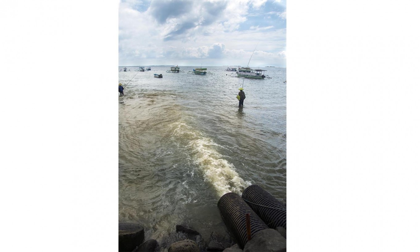 Dark waters: Liquid waste from nearby factories and companies directly goes directly into the ocean. JP/ Tarko Sudiarno