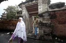 Muslims leave the mosque after prayer. JP/Boy T. Harjanto