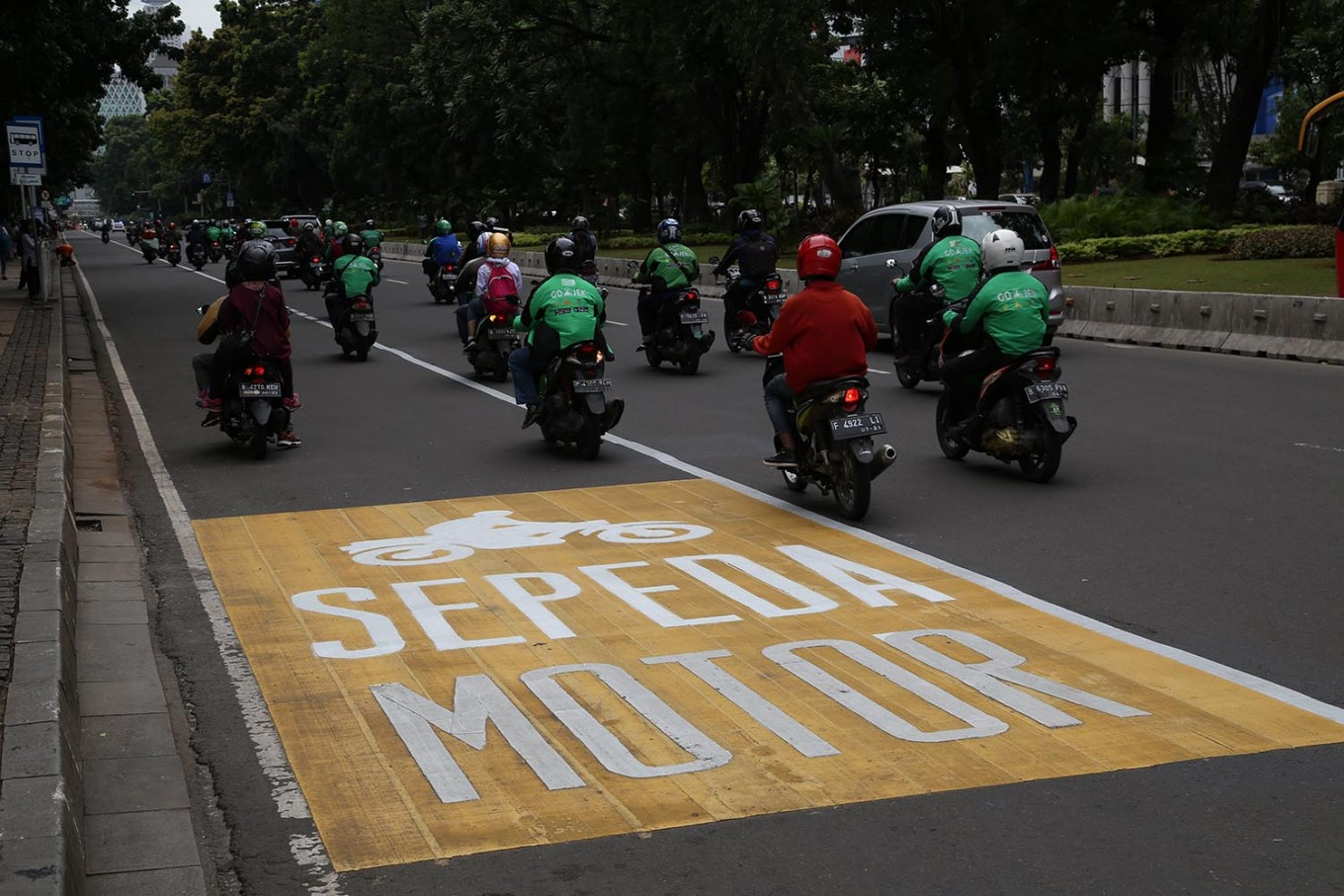 Motorcyclists drive outside a lane dedicated to motorcycles on Jl. Medan Merdeka Barat in Central Jakarta on Tuesday, January.16. JP/P.J.Leo