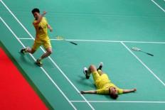 Indonesia Mens Double Kevin Sanjaya-Marcus Gideon celebrate after defeating China Li Junhui - Liu Yuche to win the at the 2018 Indonesia Masters badminton tournament at Istora Senayan, Jakarta on Sunday, January. 28. JP/Seto Wardhana