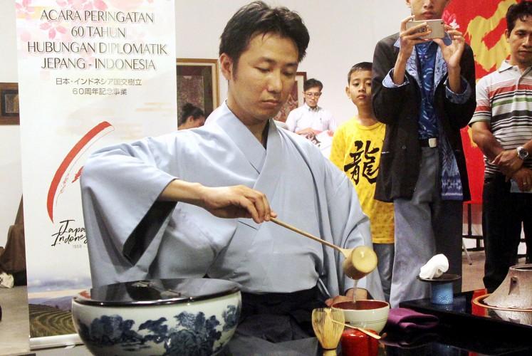 Art of tea: Shusaku Yasumaru shows how to serve traditional Japanese tea.