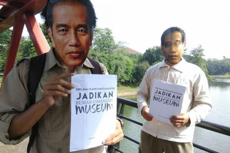 Protesters wear Jokowi masks to demand heritage protection