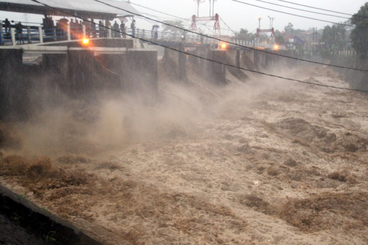 A torrent of floodwater is seen at the Katulampa sluice gate in Bogor, West Java, on Monday.