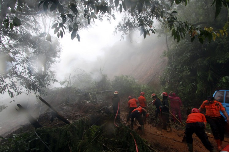 Landslides as a result of heavy downpour have affected locations in Puncak, a hilly area in Bogor, West Java, on Monday morning, forcing the authorities to temporarily close the road.
