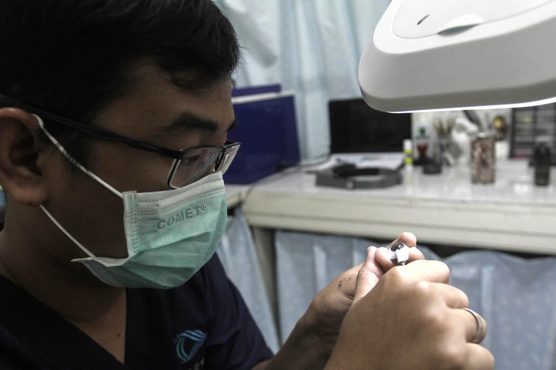Close inspection: Rizwan puts the final touches on an artificial eye. JP/ Ben Latuihamallo